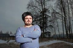 Hombre en chaleco rayado Fotos de archivo