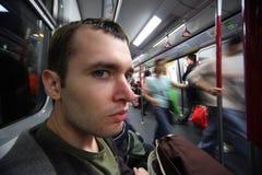 Hombre en coche de subterráneo imagen de archivo libre de regalías