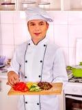 Hombre en cocinar del sombrero del cocinero Foto de archivo