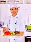 Hombre en cocinar del sombrero del cocinero Fotos de archivo