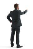 Hombre en desgaste formal que señala el dedo Foto de archivo libre de regalías