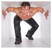 Hombre en el cubo Fotos de archivo