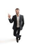 Hombre en el desgaste formal que agita su mano Imagen de archivo libre de regalías