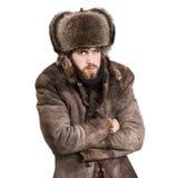 Hombre en el frío de la sensación de la capa Imagen de archivo
