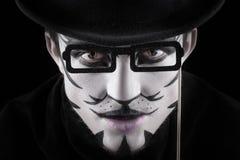 Hombre en el maquillaje, parecer un gato Imagen de archivo libre de regalías