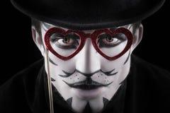 Hombre en el maquillaje, parecer un gato Imagenes de archivo