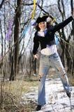 Hombre en el salto del sombrero del payaso Imagen de archivo