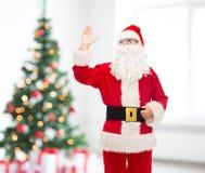 Hombre en el traje de Papá Noel Imagen de archivo