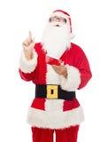 Hombre en el traje de Papá Noel con la libreta Imagenes de archivo