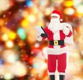 Hombre en el traje de Papá Noel con la libreta y el bolso Fotografía de archivo
