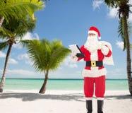 Hombre en el traje de Papá Noel con la libreta y el bolso Imágenes de archivo libres de regalías