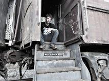 Hombre en el tren Imagenes de archivo