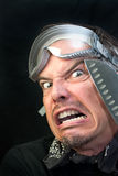 Hombre en gafas con el cuchillo, asustado Imagen de archivo