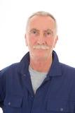 Hombre en guardapolvo azul Fotografía de archivo