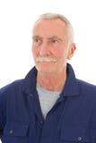 Hombre en guardapolvo azul Fotos de archivo