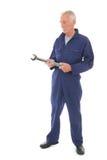 Hombre en guardapolvo azul con la llave Foto de archivo libre de regalías