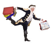 Hombre en hacer compras con el traje y la peluca viejos. Imagen de archivo