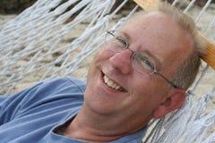 Hombre en hamaca Fotografía de archivo libre de regalías