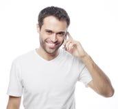 hombre en la camisa que habla en el teléfono Fotos de archivo