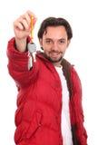 Hombre en la chaqueta con claves imagenes de archivo