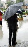 Hombre en la lluvia Imagen de archivo libre de regalías