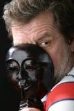 Hombre en la máscara Imagenes de archivo