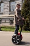 Hombre en las ruedas Imagen de archivo