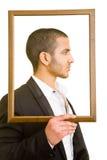 Hombre en marco Foto de archivo