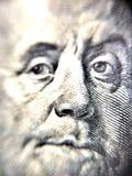 hombre en moneda del dólar de EE. UU. Fotografía de archivo