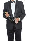 Hombre en smoking con Champán Imágenes de archivo libres de regalías