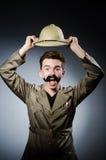 Hombre en sombrero del safari en la caza Imagen de archivo libre de regalías