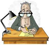 Hombre en su escritorio Fotos de archivo