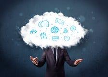Hombre en traje con la cabeza de la nube y los iconos azules Imagen de archivo
