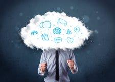 Hombre en traje con la cabeza de la nube y los iconos azules Imagen de archivo libre de regalías