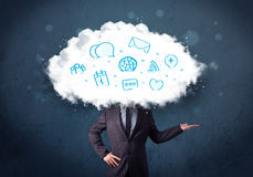 Hombre en traje con la cabeza de la nube y los iconos azules Foto de archivo