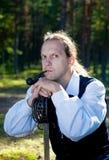 Hombre en traje escocés con la espada y el tubo Imágenes de archivo libres de regalías