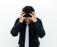 Hombre en traje negro en la acción del fracaso Imagenes de archivo