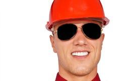Hombre en un casco protector Fotos de archivo libres de regalías