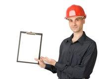 Hombre en un casco rojo del edificio fotos de archivo libres de regalías