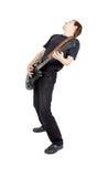 Hombre en un fondo blanco Ejecutante con una guitarra eléctrica Imagen de archivo libre de regalías