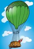 Hombre en un globo del aire caliente que pasa por alto el mundo Fotografía de archivo