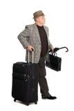 Hombre en un juego y un equipaje checkered Imagen de archivo