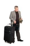 Hombre en un juego y un equipaje checkered Fotos de archivo