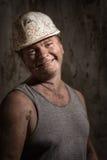 Hombre en un minero del casco Imagen de archivo
