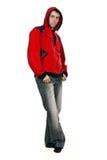 Hombre en un suéter rojo con un capo motor Fotos de archivo libres de regalías