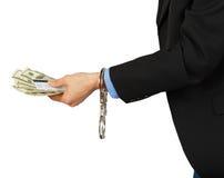 Hombre en un traje negro con los dólares y una tarjeta en las manos con la ha fotos de archivo libres de regalías