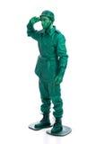 Hombre en un traje verde del soldado de juguete Imágenes de archivo libres de regalías