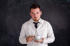 Hombre en un vestido blanco Foto de archivo libre de regalías