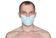 Hombre en una máscara médica aislada Foto de archivo libre de regalías