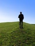 Hombre en una montaña Fotografía de archivo